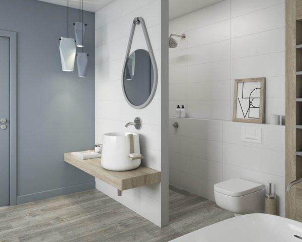 Монохромная белая плитка с квадратной мозаикой украшает ванну в скандинавском стиле.