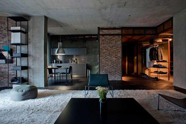 Элементы лофт в квартире: необработанные поверхности потолка и стен, кирпичная кладка.