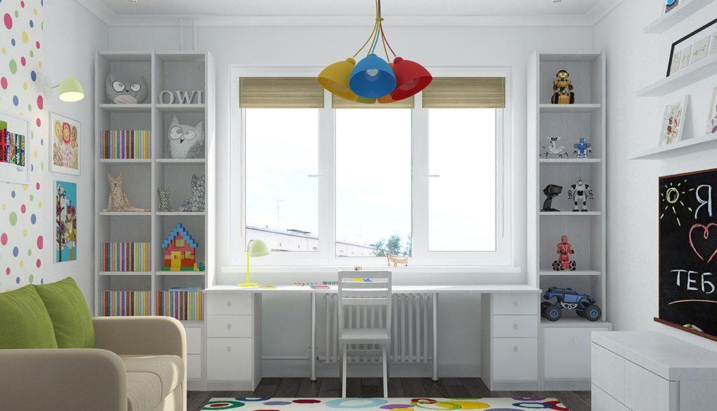 Рабочий стол возле окна в детской комнате